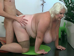 She wears a shiny pink dress and stockings for him as he fucks the pretty fat blonde chick