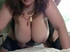 Mature lady gets jizz on huge boobs