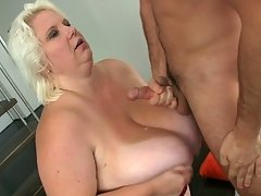 He has her bent over on the stairs and he fucks her BBW pussy hard before cumming on her tits