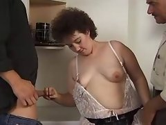 Chubby milf sucks cocks on kitchen