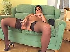 Plump mature sucks chocolate cock